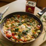 Shakshouka with fava beans, corn & mozarella